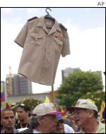 Protesters hold up an army shirt during the protest