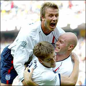 England celebrate taking the lead against Brazil
