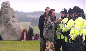 Police talk to revellers at the Stonehenge stones