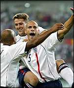Ferdinand celebrates after scoring against Denmark