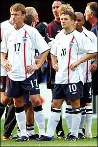 Teddy Sheringham (left) and Michael Owen reflect on England's exit