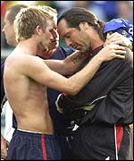 David Seaman is consoled by David Beckham