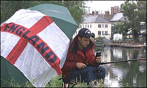 One fisherman on the River Cam, in Cambridgeshire, decided to watch the game alone