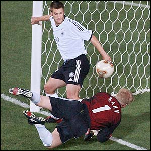 Torsten Frings and goalkeeper Oliver Kahn clear a goalbound shot from the line