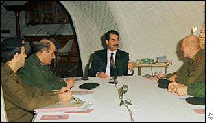 Saddam Hussein and his advisers