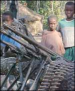 Children with artillery inside camp