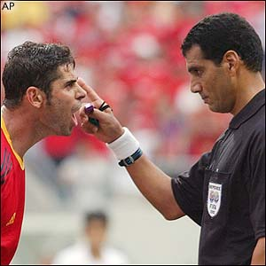 Spain's captain Fernando Hierro argues with Egyptian referee Gamal Ghandour