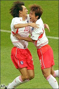 South Korea's Hong Myung-Bo is congratulated by his team-mate Hwang Sun-Hong after scoring the winning penalty