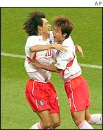 South Korea's Hong Myung-Bo is congratulated by his team-mate Hwang Sun Hong