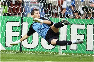 Spain's goalkeeper Iker Casillas dives the wrong way as South Korea score their winning penalty