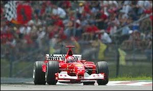 Ferrari's Michael Schumacher pays the price for a mistake on his final qualifying lap and will start the race from third on the grid