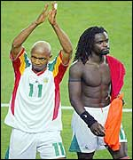 Diouf and Coly wave to their supporters