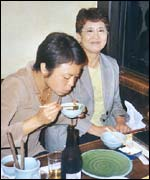 Japanese diners eating in whalemeat restaurant
