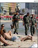 Israeli border police patrol on Tel Aviv beach