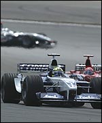 Ralf Schumacher heads Michael Schumacher in the early laps with David Coulthard looming up behind