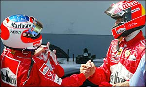 Rubens Barrichello and Michael Schumacher congratulate each other