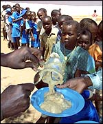 Children queuing for food aid