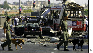 Israeli police check the wreckage of a bus in Jerusalem on 18 June following a suicide bombing