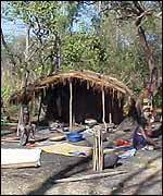 Villagers in front of their shelter