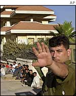 Israeli soldier with Palestinian detainees