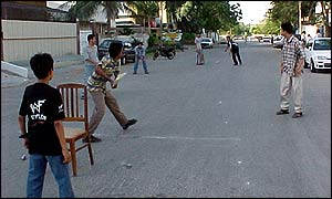 A Street Cricket Scene In Pakistan
