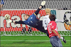 Germany's goalkeeper Oliver Kahn makes a superb save from a powerful Lee Chun-Soo strike