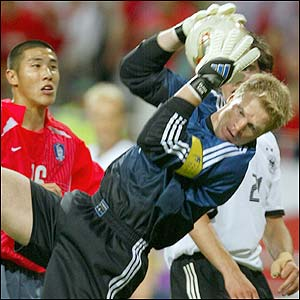 Germany's goalkeeper Oliver Kahn catches a high ball under pressure from Cha-Doo-Ri