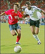 Marco Bode of Germany battles for the ball with Sun Hong-Hwang
