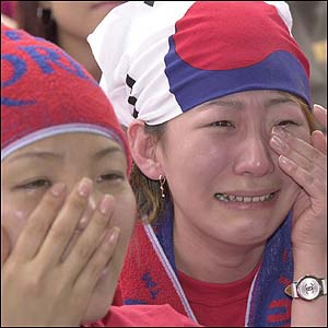South Korean fans in New Malden, England are left in tears after witnessing their team's loss on television