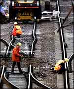 Engineers examine the tracks and points at Potters Bar