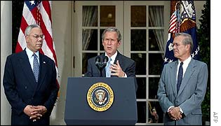 President Bush delivering Monday's speech, with Secretary of State Powell and Defence Secretary Rumsfeld