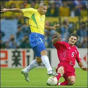 Ronaldo is tackled by Turkey centre-back Alpay