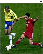 Brazil's Rivaldo (left) tries to break away from Turkey's Yildiray Basturk