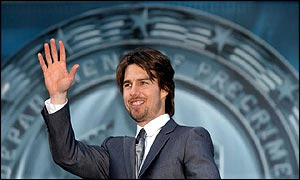 Tom Cruise waves to the crowd