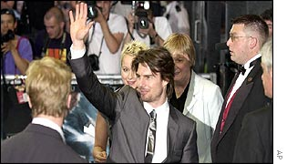 Tom Cruise waves to the crowd before entering the cinema