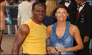 Chris and Karron Eubank pose for photographers