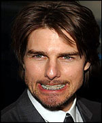 Tom Cruise shows off his brace