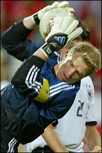 Captain Oliver Kahn of Germany plucks another shot out of the air