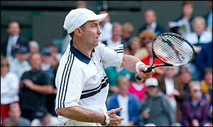 Karl Power returns a shot to his friend on Centre Court