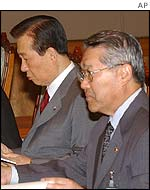 President Kim of South Korea (left)