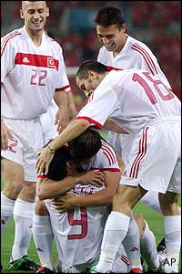 Turkey players congratulate Hakan Sukur after his early goal against Korea