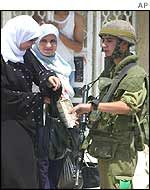 Palestinian women at an Israeli checkpoint