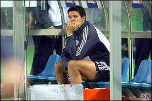 Germany midfielder Michael Ballack watches from the dugout as the match begins