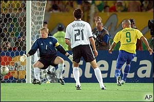 Germany keeper Oliver Kahn watches as Ronaldo's shot trundles wide of the German goal