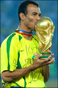 Captain Cafu lifts the trophy for Brazil