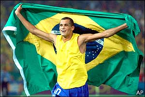 Rivaldo celebrates with the Brazilian flag