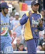 Jayawardene cradles the wounded bird as Sachin Tendulkar looks on