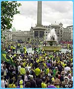 Brazilian fans celebrate in Trafalgar Square