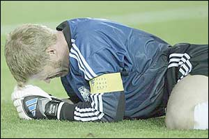 Oliver Kahn lies dejected after his error hands the first goal of the final to Brazil's Ronaldo