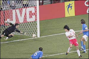 Ahn Jung-Hwan makes up for his early penalty miss by slotting the winner past Gianluigi Buffon in extra time